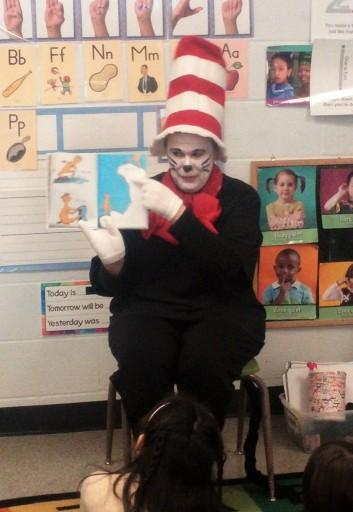Cat in the Hat reading to children